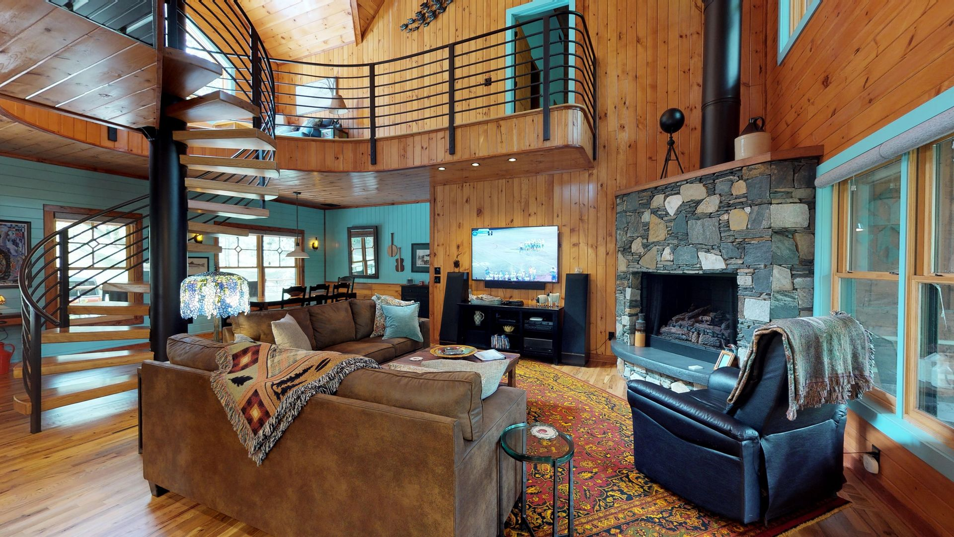 Living room with 2 couches and gas log fireplace
