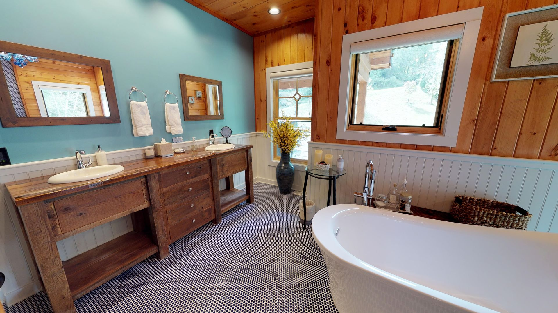 Bathroom with double vanities and tub