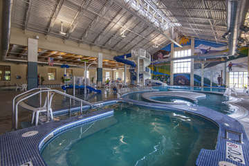 Rec Center with multiple swimming pools and waterslide