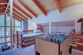 Loft with 4 twins and Foosball (Cubbies in background each have 1 Twin, plus daybed trundle on left)