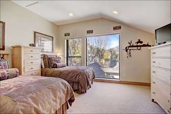 Two Twin Beds and a Flat Screen TV in the Third Bedroom