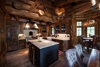 Gourmet kitchen features state of the art appliances including Wolf double oven