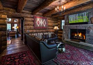 Comfortable den with roaring fireplace