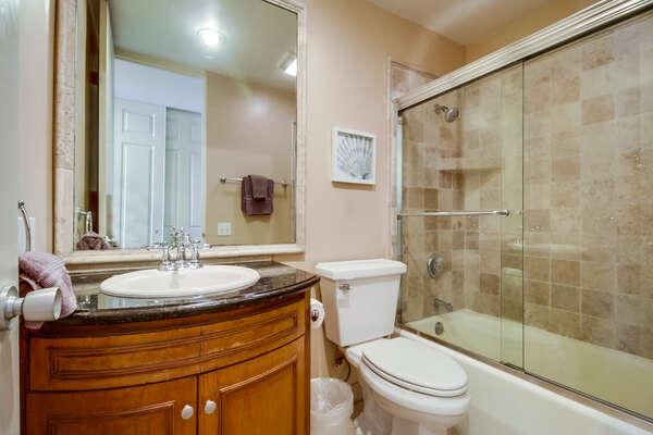 Bathroom with shower/tub combo, hallway access