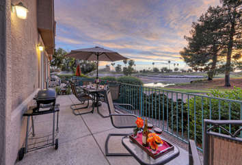 Extra-large private patio with Weber electric grill has magnificent views of the golf course