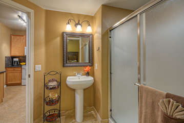 Second bath features a walk-in shower and is accessed from the kitchen and second bedroom