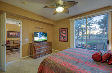 The master suite has views of Superstition Springs Golf Course and access to the private patio