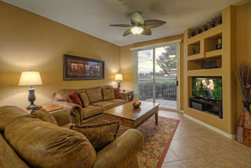 A great room with access to the private patio is professionally decorated to be attractive and comfortable
