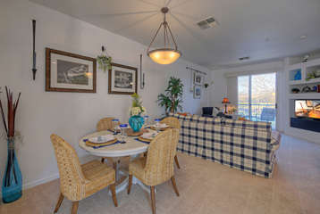 Cozy dining area with table seating between great room and kitchen