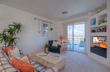 Watch TV or exit to private balcony from great room