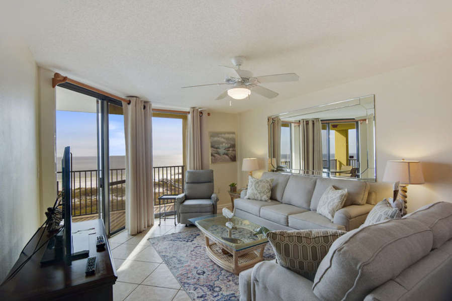 Spacious Living Area with a Sleeper Sofa and Access to the Balcony