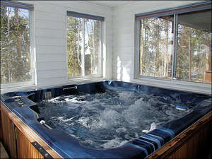 Private Indoor Hot Tub with windows for letting in the cool mountain air.