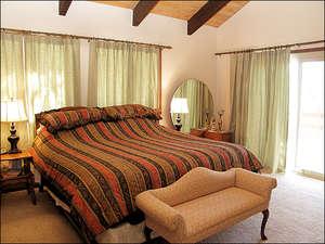 Bedroom 1 - King, TV, Balcony, Shuttered Window to Living Room below