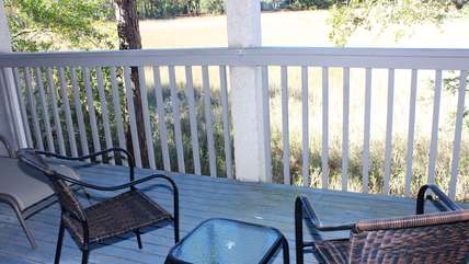 Step onto the porch to watch the wildlife on the marsh.