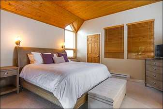 Warm and Bright Master Bedroom Suite