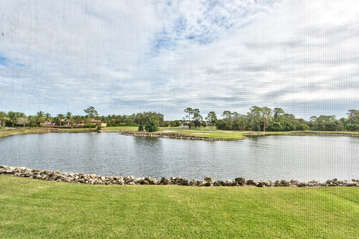 View From Private Lanai with Table and Seating; Fan; Overlooking Scenic Lake and Championship Golf Courses! Breathtaking Views of Sunrise!