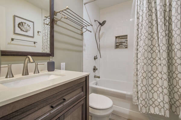 Bathroom with standing shower/tub combination
