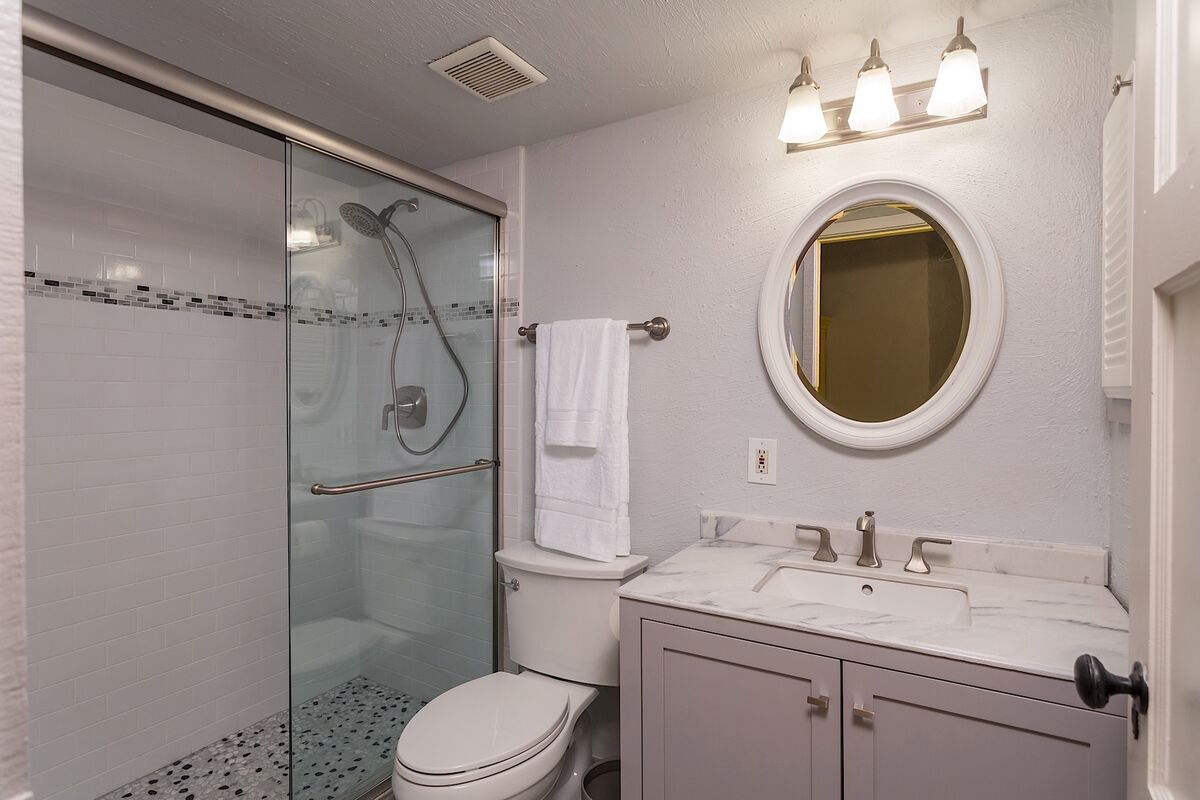 Updated bathroom with a walk-in shower and a mobile shower head for added accessibility