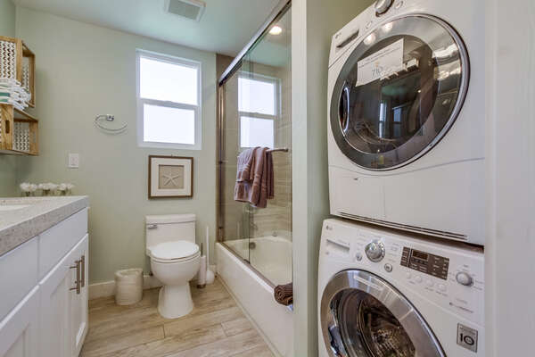 laundry in full bathroom with shower/tub combo, 2nd floor