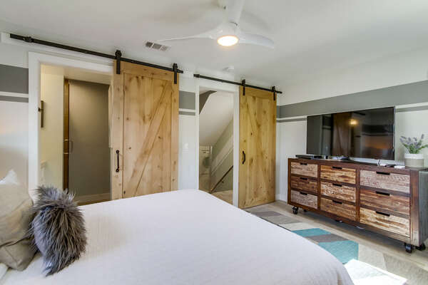 Master bedroom with ensuite bathroom and walk-in closet, queen bed