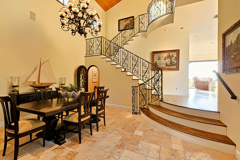 Formal dining area at the foot of the grand stairs