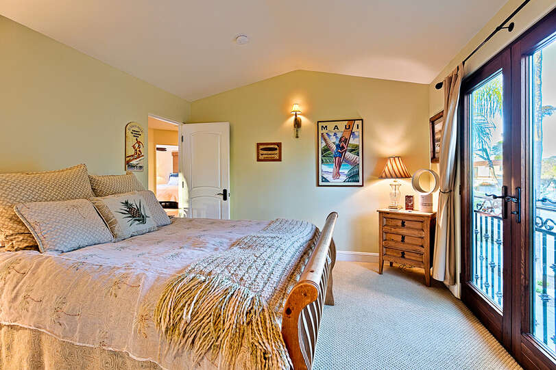 This bedroom features high ceiling and a great view