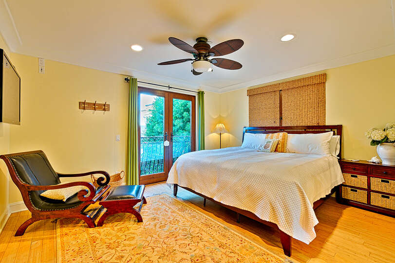 Queen bed with lounge seating and TV