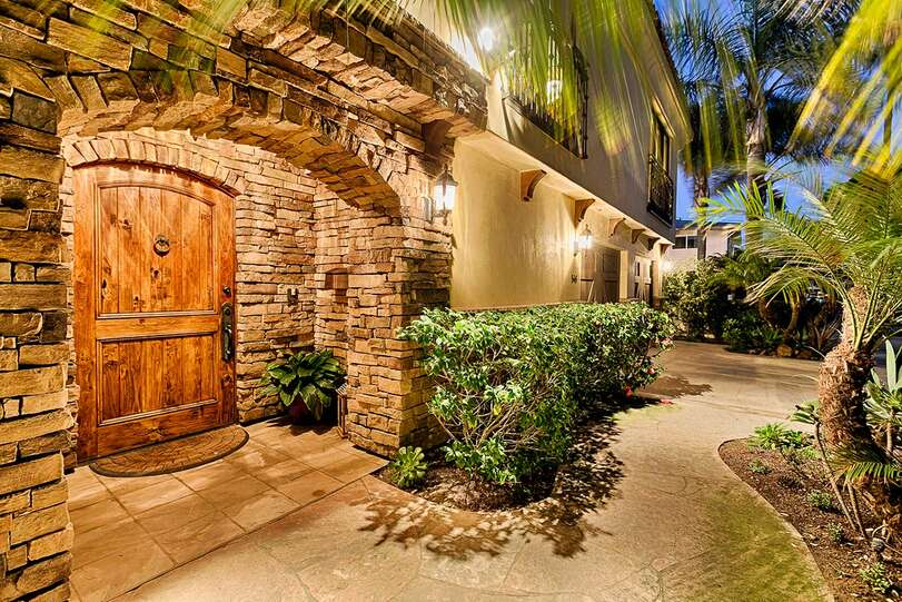 A warm welcome with wood and stone entryway