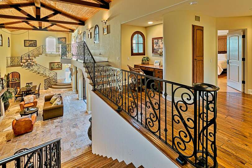 Beautiful ironwork and wood floors add luxury