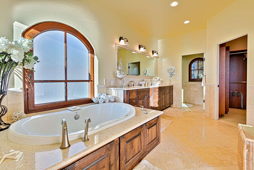 Master suite features a spa-like bath