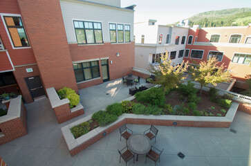 A birds-eye view of the patio and adjoining rooftop open space