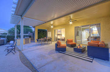 Cozy sitting and dining areas on large covered patio are perfect for relaxing quietly or more exciting festivities