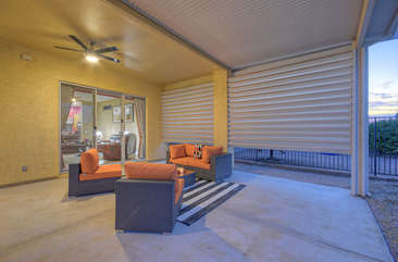 Chill and chat in style on spacious covered patio with complimentary furnishings