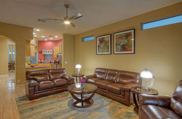 Great room with transom windows is furnished with plush seating for group gatherings