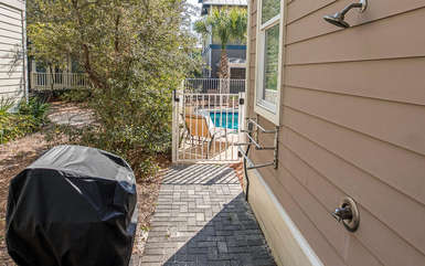 Back path with outdoor shower and gas grill