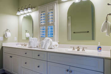 Double sinks with plenty of counter space in this master bathroom.