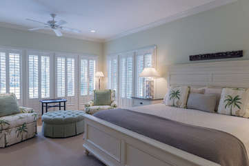 Sitting area in Master Bedroom with lots of windows.