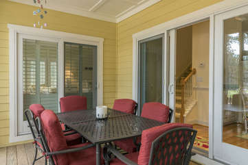 Relax on the screened porch with access from the living room, the master bedroom, and the sun room.