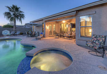 A magnificent backyard oasis with heated pool, spa, built in grill and citrus trees is waiting for you!