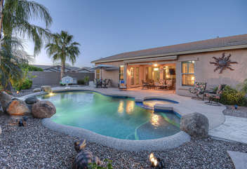 Water feature and custom pool make home your own private paradise
