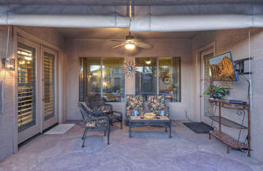 Longing to be outdoors but do not want to miss your favorite team play? Enjoy both on charming covered porch with mounted television.