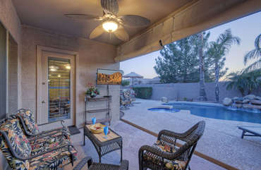 A delightful covered porch to enjoy the warmth of the spectacular southwest and views of the water features