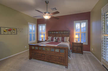 Master bedroom has gorgeous king bed and doors to access back patio