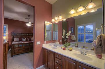Dual vanity sinks in stylish master bath