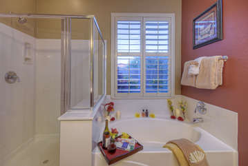 Master bath includes divine garden tub and separate shower for soaking or rinsing away the desert sand