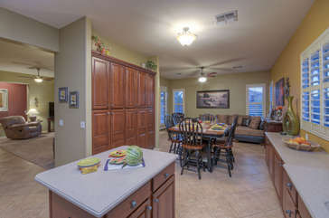 Open floor plan offers bright living spaces that include a living room and family room