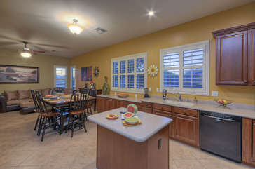 Kitchen with island opens into eating area and comfie family room