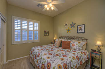 Attractive second bedroom has inviting king bed