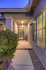 Front entrance welcomes you to custom home with many appealing qualities