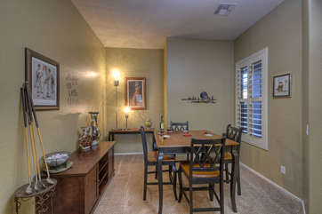 Breakfast nook also functions as an office with a writing desk in recessed alcove for work that travels with you